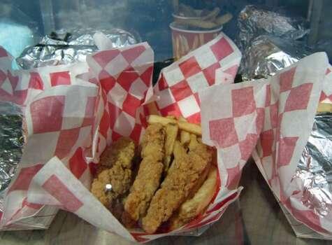 A chicken strip basket on the Pleasure Pier.  (Syd Kearney / Houston Chronicle)