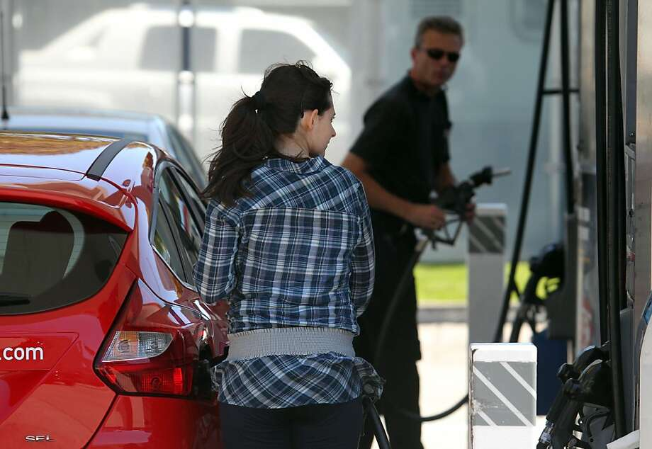 Patrons fill up at a gas Station at the corners of Sixth Street and Harrison, San Francisco Calif. Photo: Lance Iversen, The Chronicle