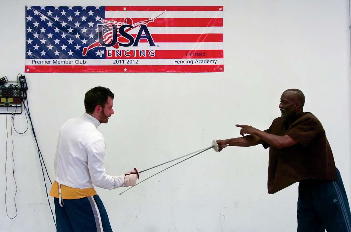 Reporter Scott Gargan learns about fencing from Coach John Mobley for the Have You tried...? feature in the Health and Fitness section at Fairfield Fencing Academy in Fairfield, Conn. on Friday June 22, 2012.