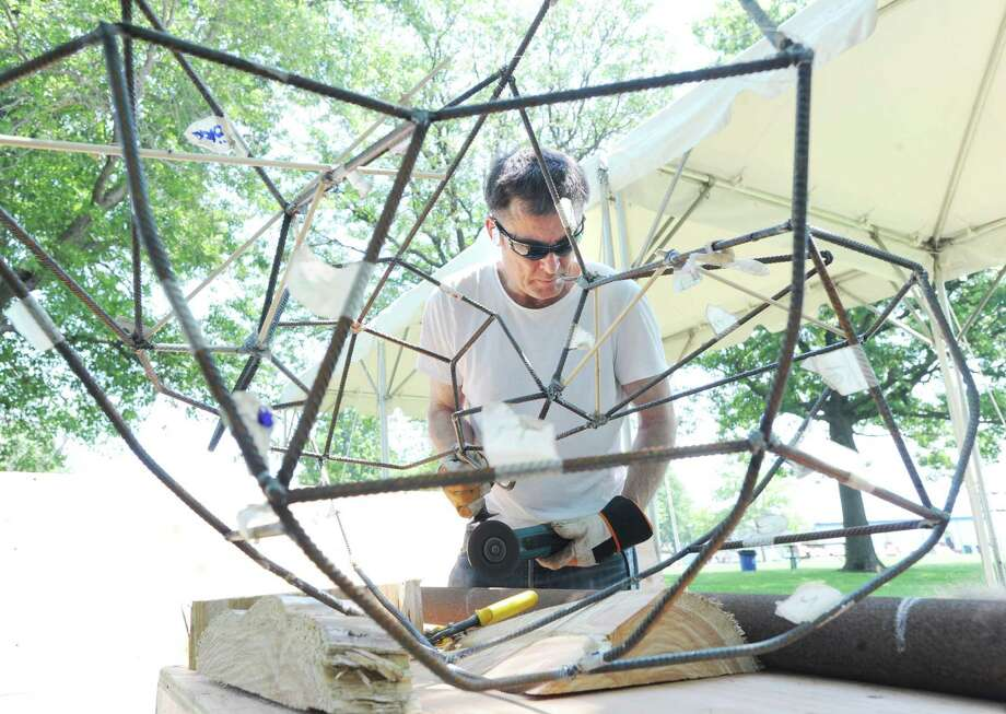 Swedish artist Michael Hedman creates a steel sculpture in Roger Sherman Baldwin Park in Greenwich, Friday, June 29, 2012. Hedman was part of a small group of artists brought together by Mary Gibbons of Greenwich to create sculptures for the park. Photo: Bob Luckey / Greenwich Time
