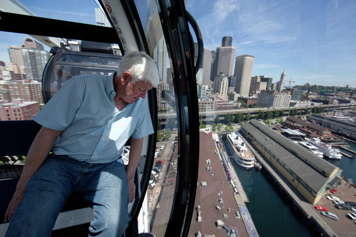 Hal Griffith, owner of Seattle's Pier 57, rides on the new Seattle Great Wheel on Wednesday, June 27, 2012. The observation wheel on the Seattle waterfront takes riders more than 175 feet over Puget Sound, offering a new view of the Seattle waterfront. The Great Wheel, featuring enclosed gondolas, opens to the public on Friday, June 29th.