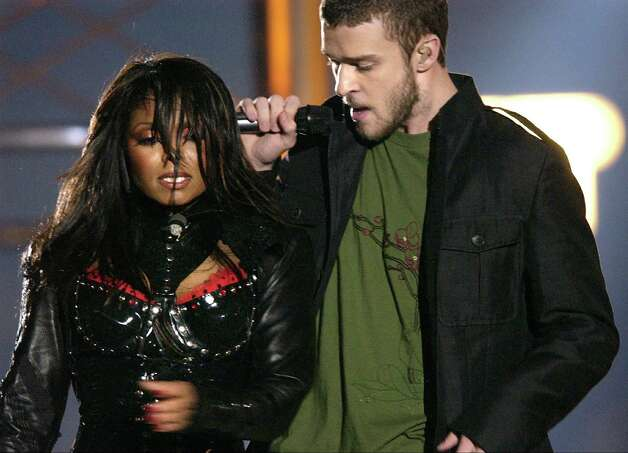 "FILE - In this Feb. 1, 2004 file photo, singers Justin Timberlake and Janet Jackson are seen during their performance prior to a wardrobe malfunction during the half time performance at Super Bowl XXXVIII in Houston. The Supreme Court decided Friday not to consider reinstating the government's $550,000 fine on CBS for Janet Jackson's infamous breast-bearing ""wardrobe malfunction"" at the 2004 Super Bowl. (AP Photo/David Phillip, file) Photo: DAVID PHILLIP"