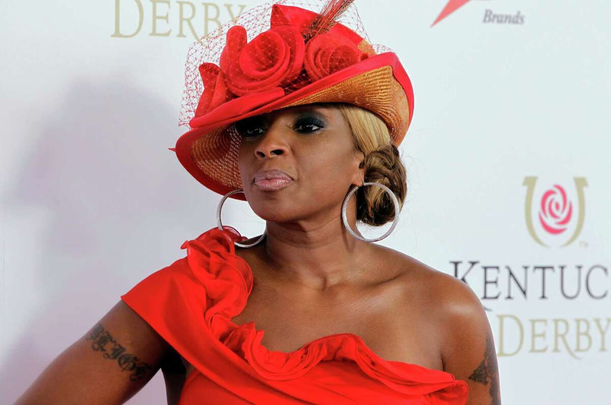 FILE - In this May 5, 2012 file photo, singer Mary J Blige arrives for the 138th Kentucky Derby horse race at Churchill Downs, in Louisville, Ky. Blige says the Burger King commercial that caused major backlash for the singer was a ?