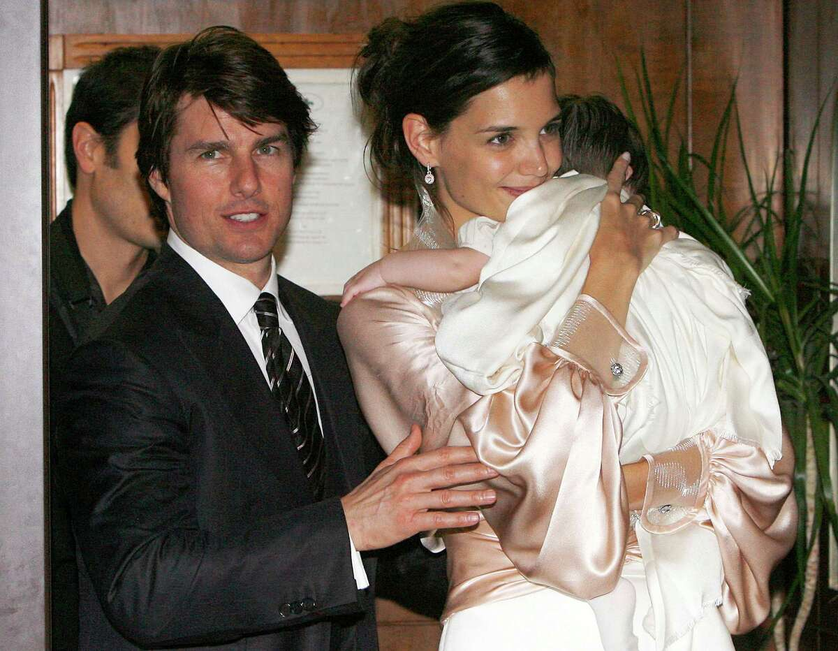 FILE - In this Nov. 17, 2006 file photo, U.S. actor Tom Cruise, and U.S. actress Katie Holmes with their daughter Suri, who became engaged in June 2005, leave a restaurant in Rome. Cruise and Homes are calling it quits after five years of marriage. Holmes' attorney Jonathan Wolfe said Friday June 29, 2012 that the couple is divorcing, but called it a private matter for the family. (AP Photo/Alessandra Tarantino, File)