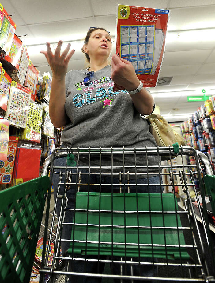 Charlenee Hardee shops for supplies for a ninth grade class she teaches at Memorial High School at the Dollar Tree in Beaumont, Thursday, June 28, 2012. Tammy McKinley/The Enterprise Photo: TAMMY MCKINLEY