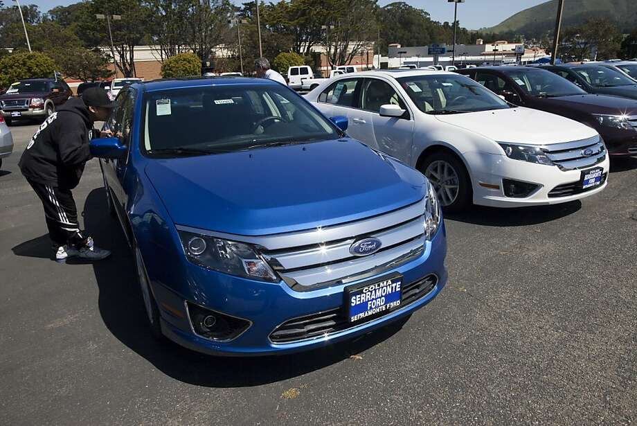 COLMA, CA - APRIL 26:  A customer looks over a Ford Fusion parked on the lot at the Serramonte Ford dealership on April 26, 2011 in Colma, California.  Benefiting from strong demand for smaller cars and pickups Ford Motor Co. beat out Wall Street's estimates by reporting its best first quarter earnings since 1998 with a reported earnings of 2.6 billion dollars. Photo: David Paul Morris, Getty Images