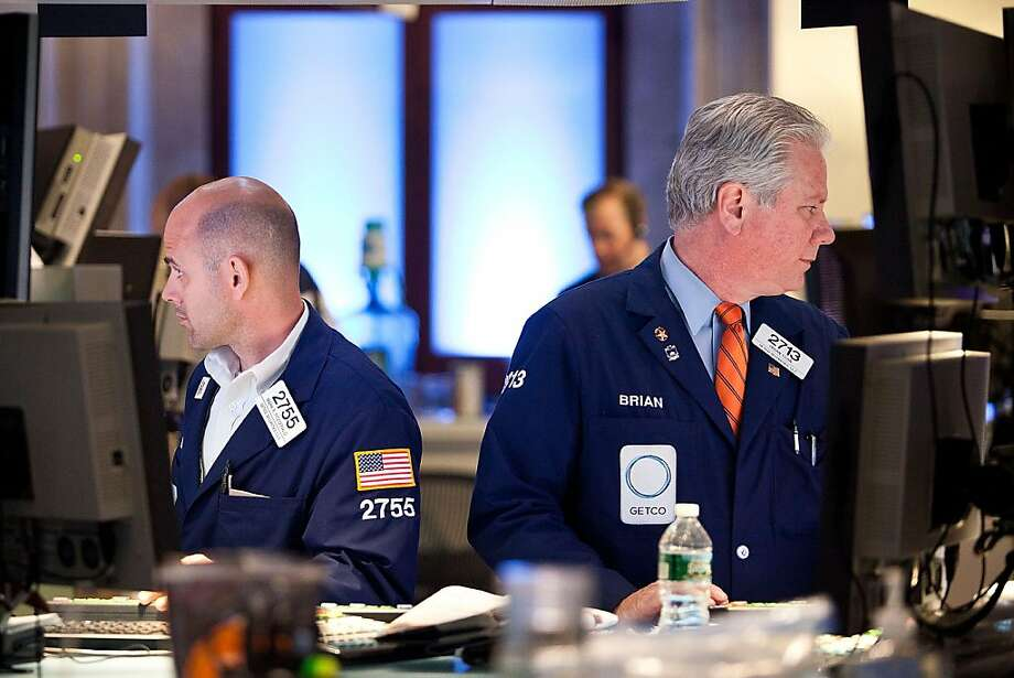 NEW YORK, NY - JUNE 29:  Traders work on the floor of the New York Stock Exchange on June 29, 2012 in New York City. The market soared over 2% in New York in response to the Euro Zone bail out package.  (Photo by Andrew Burton/Getty Images) Photo: Andrew Burton, Getty Images