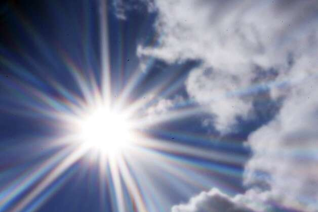 Exposure to UV can be higher when the sun is near a cloud and the sky is clear and blue, as illustrated by this pinhole photograph. Photo: Forrest M. Mims III, For The Express-News