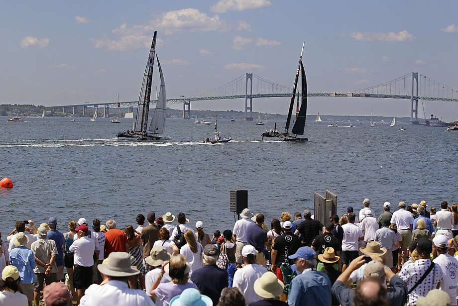 Spectators at Fort Adams State Park watch a match race at the first day of the America's Cup World Series regatta in Newport, RI., Thursday, June 28, 2012. State tourism officials say 7,400 people attended the first day of racing and hope 50,000 people in total will visit the nine-day event, which features four days of racing.  (AP Photo/Stephan Savoia) Photo: Stephan Savoia, Associated Press