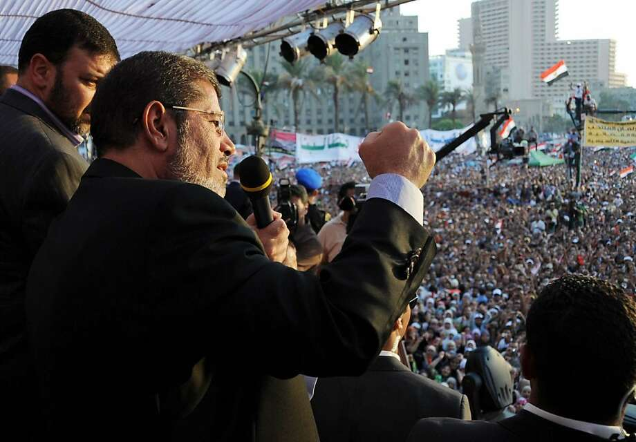 "In this handout picture made available by the Egyptian presidency, Egypt's Islamist president-elect Mohamed Morsi addresses tens of thousands of Egyptians in Cairo's iconic Tahrir Square on June 29, 2012. Morsi paid tribute to Egypt's Muslims and Christians alike and symbolically swore himself in as the country's first elected civilian president. AFP PHOTO / HO ==RESTRICTED TO EDITORIAL USE - MANDATORY CREDIT ""AFP PHOTO /EGYPTIAN PRESIDENCY "" - NO MARKETING NO ADVERTISING CAMPAIGNS - DISTRIBUTED AS A SERVICE TO CLIENTS==-/AFP/GettyImages Photo: -, AFP/Getty Images"