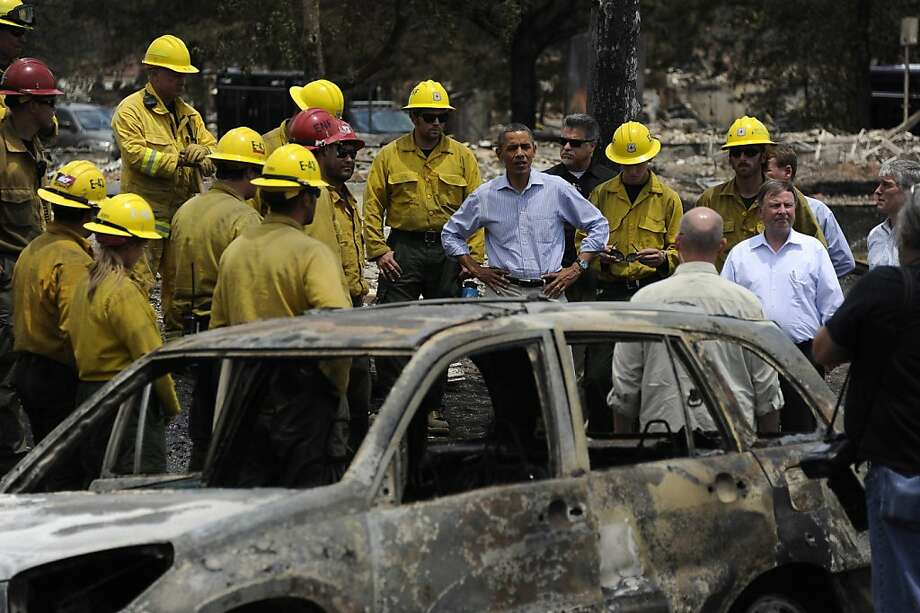 President Barack Obama talks with firefighters in Mountain Shadow as he toured decimation from The Waldo Canyon Fire in Colorado,Friday, June 29, 2012. (Mark Reis/Colorado Springs Gazette/MCT) Photo: Mark Reis, McClatchy-Tribune News Service