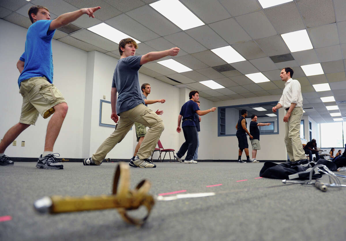 The Connecticut Free Shakespeare Company held sword fight scene rehearsals with choreographer Jacb Grigolia-Rosenbaum, at right, for their production of Romeo and Juliet, which was held in the Bank of America building in downtown Bridgeport, Conn. on Friday June 29, 2012.