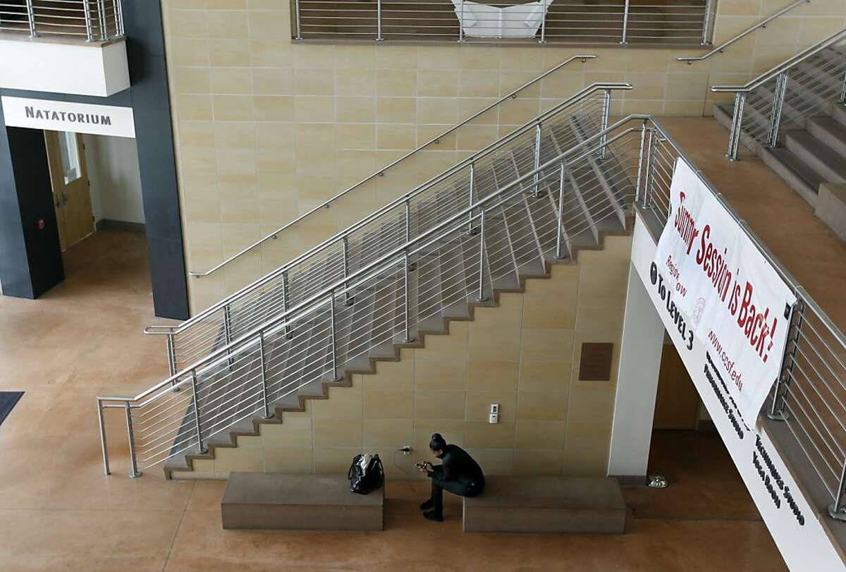 A student sits on the ground level of the Wellness Center on the main CCSF campus in San Francisco, Calif. on Friday, June 29, 2012.