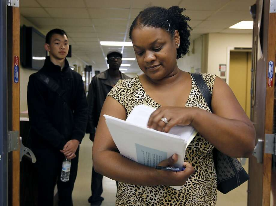 Tracey Western waits to speak to an admissions clerk on the main CCSF campus in San Francisco, Calif. on Friday, June 29, 2012. Photo: Paul Chinn, The Chronicle