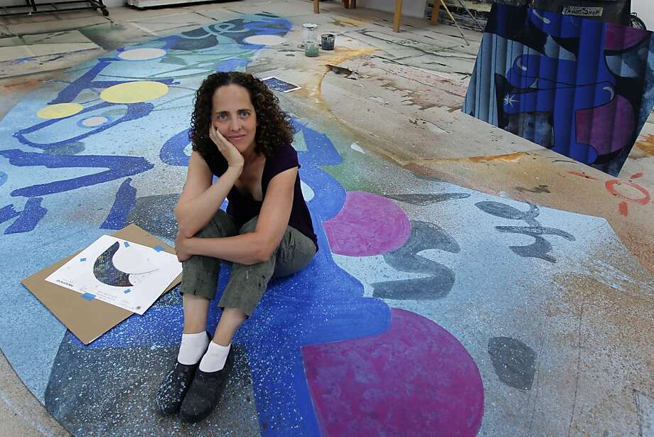 "Lisa Lazar paints a set for the Berkeley Repertory Theatre production of ""Emotional Creature."" Photo: Paul Chinn, The Chronicle"