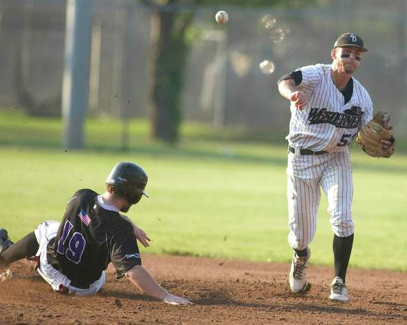 Westerners' shortstop Zach Shank turns a double play against the Keene Swamp Bats Friday night at Rogers Park. Photo: Barry Horn / The News-Times Freelance