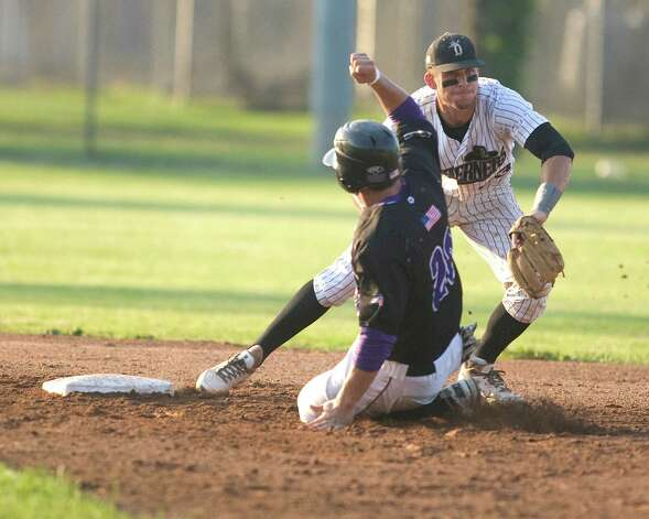 Westerners shortstop Zach Shank gets the force out on Keene's Dylan DelaCruz during their NECBL game Friday night at Rogers Park. Photo: Barry Horn / The News-Times Freelance