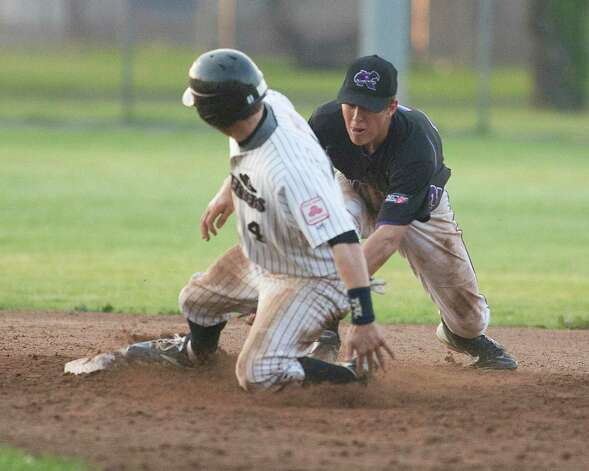 The Westerners' Mathew Boulter slides safely into second base with a double as Keene's Dylan Moore is late with the tag Friday night at Rogers Park. Photo: Barry Horn / The News-Times Freelance