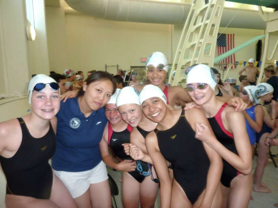 The Greenwich YMCA Marlins Swim Team made a strong showing recently at the last long course qualifier of the season, which was hosted by the Y. Pictured above are Marlins swimmer Jillian Leigh, Head Coach Connie Wu, and swimmers Paige Furano, Sophia Moore, Sophie Jahan and Paula Scanlan. In the back row is Marlin Christina Chao. Photo: Contributed Photo