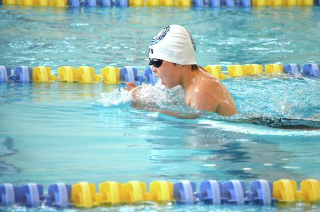 Mark Chen, 8, of the Greenwich YMCA Marlins, swims hard to place in the boys 10/U 50 breaststroke. Chen qualified for Age Groups and will swim at the Connecticut State Age Groups on July 26t. Photo: Contributed Photo