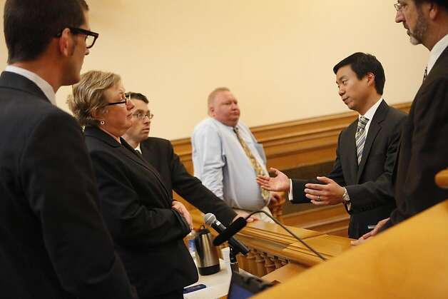 Commission President Benedict Hur (second from right) talks to  attorney David Waggoner (left), Deputy City Attorney Sherri Kaiser (second from left) and Deputy City Attorney Peter Keith (third from left) as they gather in Room 400 after suspended Sheriff Ross MirkarimiÕs official misconduct hearing was abruptly adjourned in City Hall on Friday, June 29, 2012 in San Francisco, Calif. Photo: Lea Suzuki, The Chronicle