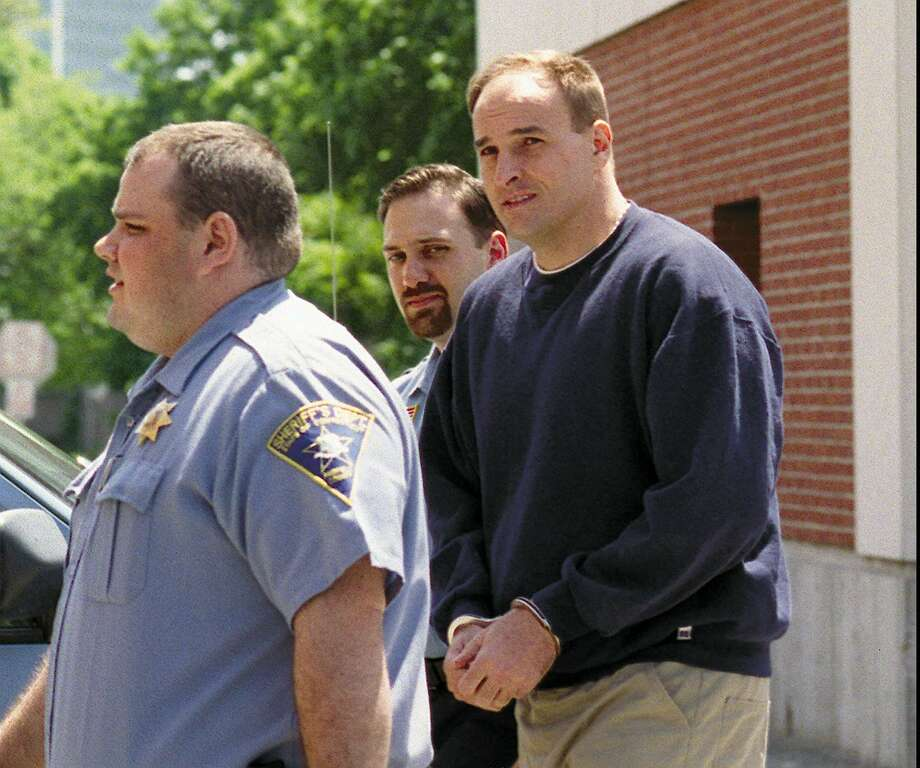 Andrew Wilson, a Greenwich native, is led into state Superior Court in Stamford for a competency hearing May 26, 1998, in connection with the 1993 murder of Greenwich resident John Peters. Photo: Greenwich Time File Photo