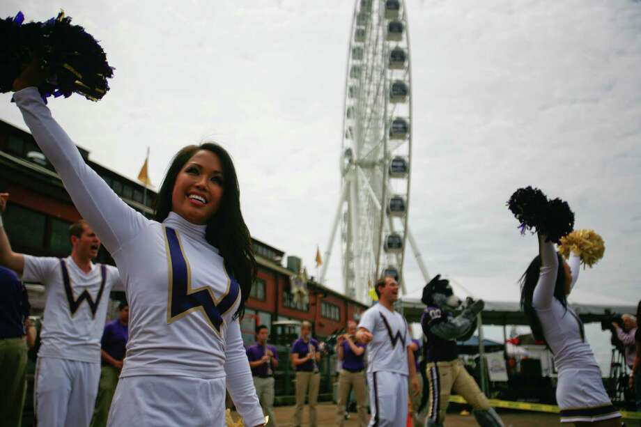 Karissa Fogel from the University of Washington Spirit Squad performs at the opening ceremony for The Seattle Great Wheel at Pier 57 in Seattle on Friday, June 29, 2012. Photo: SOFIA JARAMILLO / SEATTLEPI.COM