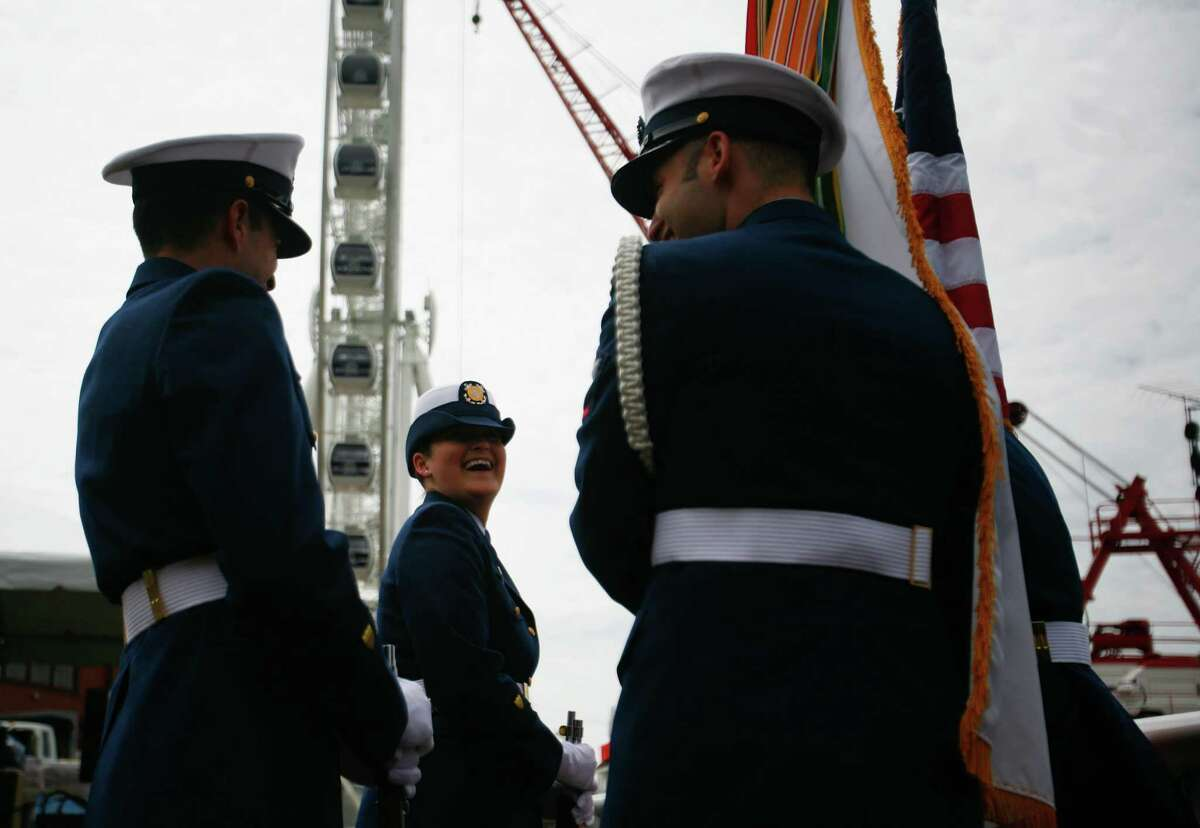 Amanda Cloer, a petty officer in the U.S. Coast Guard, prepares to present the colors.