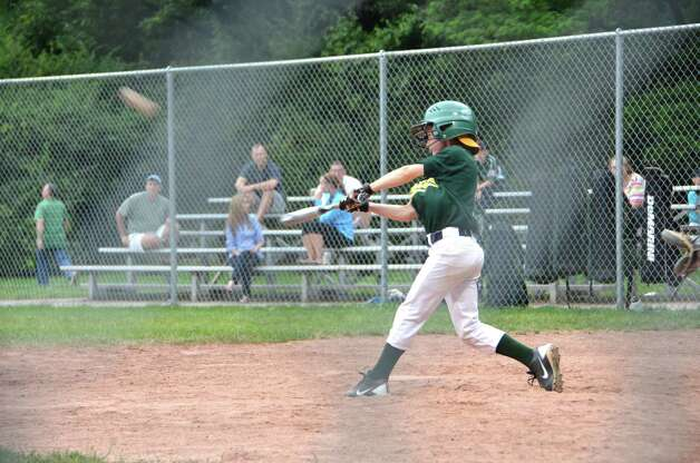 Cole Price rips into one for the Athletics during Cal Ripken Major League Championship play. Photo: Contributed Photo