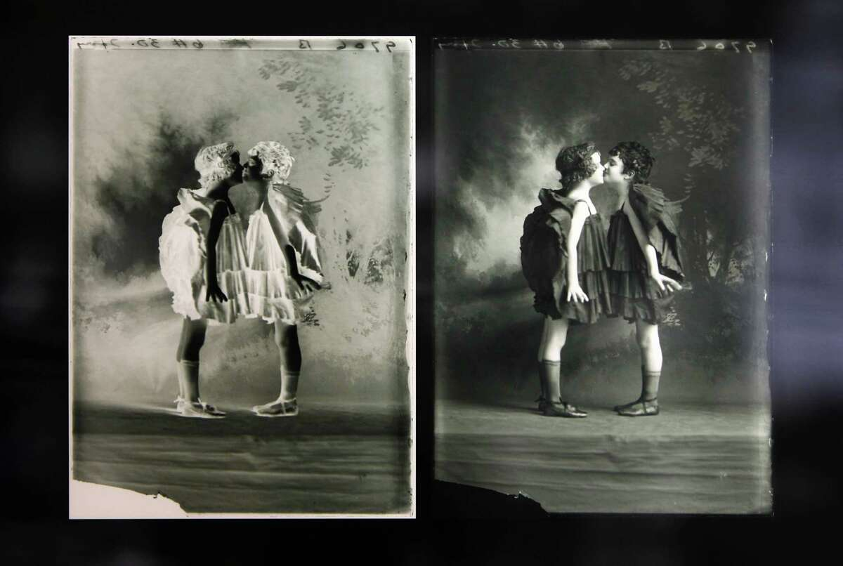 A glass negative and it's positive image are displayed images and reproduced in a contemporary light box installation at the Faces, Places & Spaces exhibit at the Julia Ideson Building, Thursday, June 21, 2012, in Houston. The Houston Metropolitan Research Center (HMRC) is home to thousands of glass plate negatives capturing Houston and its citizens from the late 1800s. Although the majority of the images are an assortment of studio portraits, street scenes, and residences, other subjects and places are also represented. (Karen Warren / Houston Chronicle )