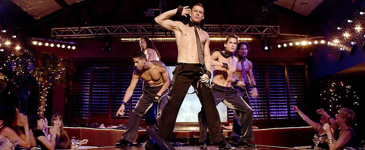 """This film image released by Warner Bros. shows, from left, Adam Rodriguez, Kevin Nash, Channing Tatum, Matt Bomer and Joe Manganiello in a scene from """"Magic Mike."""" (AP Photo/Warner Bros.)"""