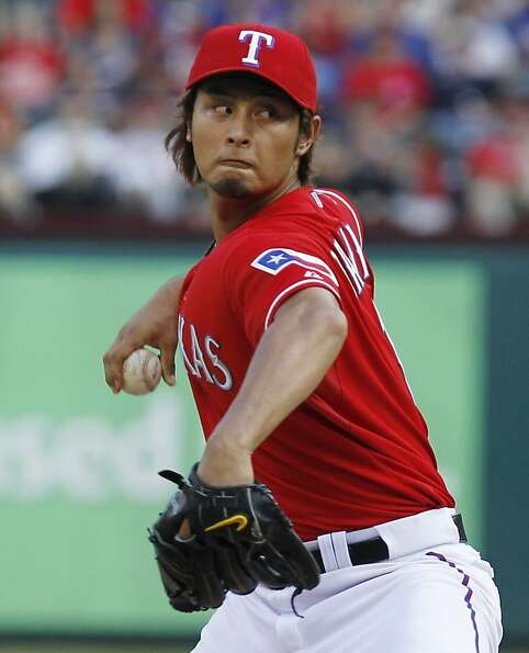 Texas Rangers starting pitcher Yu Darvish throws against the Detroit Tigers in Arlington, Texas on T