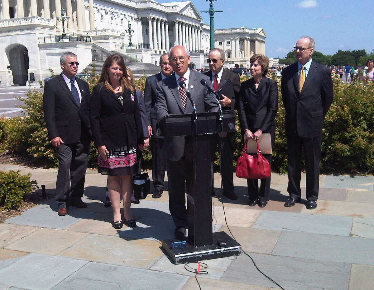 U.S. Rep. Paul Tonko holds a press conference in Washington D.C. To reintroduce legislation motivated by the death of Cobleskill trucker, Jason Rivenburg on May 11, 2011. Hope Rivenburg, the widow of Jason Rivenburg, for whom the trucker-parking law is named, is pictured left. (Hearst Washington Bureau/archive)