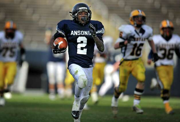 Ansonia's Arkeel Newsome breaks away as he carries the ball Saturday, Dec. 10, 2011 during the Class M State Championship football game against Ledyard at Rentschler Field in East Hartford, Conn. Photo: Autumn Driscoll / Connecticut Post