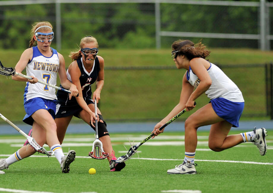 Newtown's Anna Northrop, left, New Fairfield's Casey Jagemann, center, and Newtown's Riley Wurtz compete for the loose ball during their Division I SWC championship game at Newtown High School on Friday, May 25, 2012. Newtown won 18-13. Photo: Jason Rearick / The News-Times