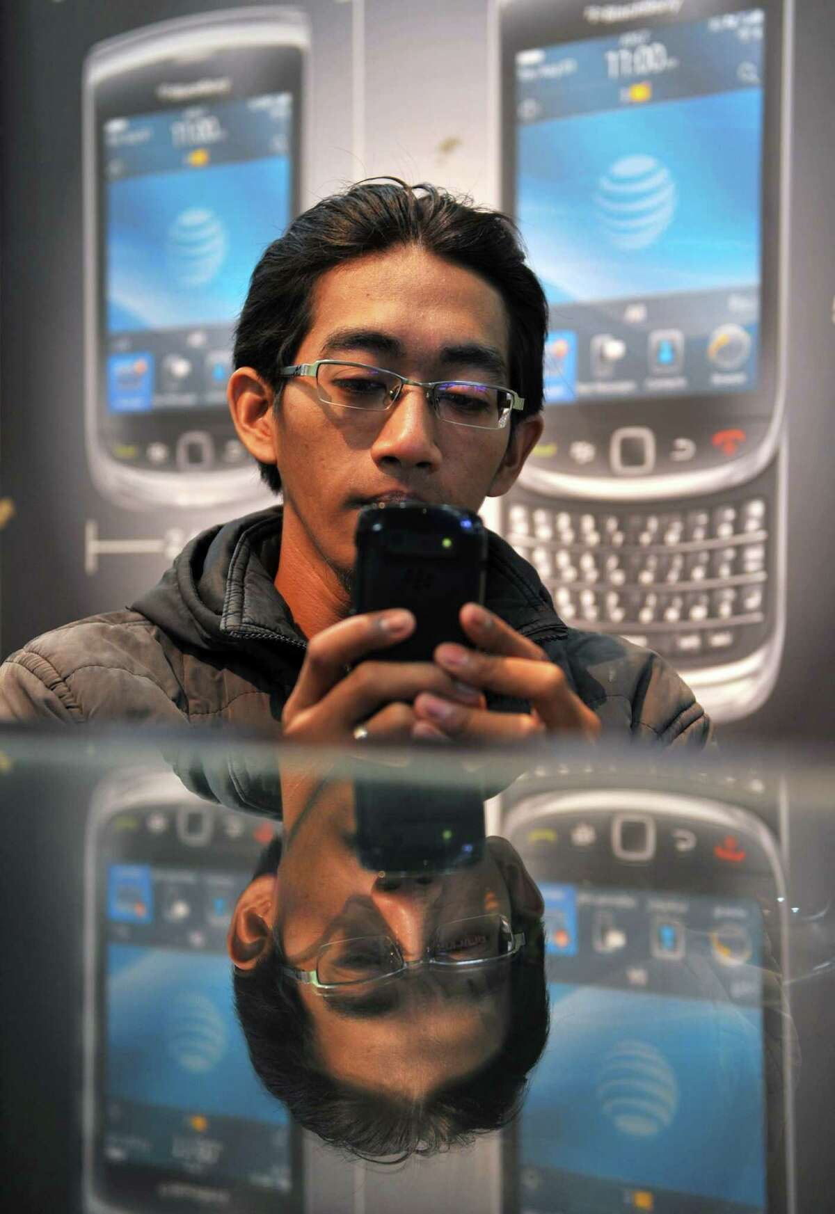 A customer in Jakarta, Indonesia, tries out a BlackBerry. RIM portrays the BlackBerry 10 system as its way to catch up, but it won't be out until 2013.