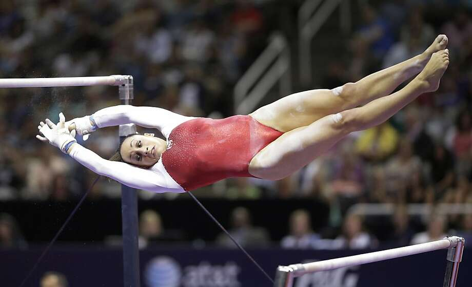 Jordyn Wieber flips from one bar to the other on the uneven bars during the preliminary round of the women's Olympic gymnastics trials, Friday, June 29, 2012, in San Jose, Calif. (AP Photo/Jae C. Hong) Photo: Jae C. Hong, Associated Press