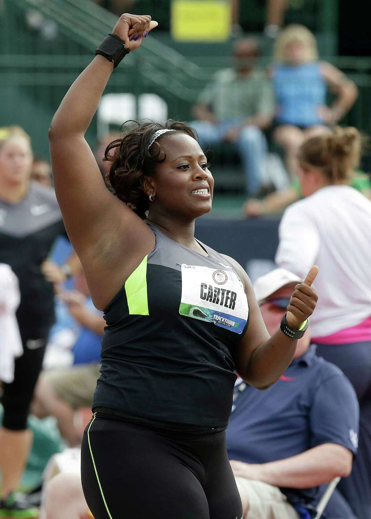 Michelle Carter reacts after the final round of the women's shot put at the U.S. Olympic Track and Field Trials Friday, June 29, 2012, in Eugene, Ore. Carter placed second. (AP Photo/Charlie Riedel)