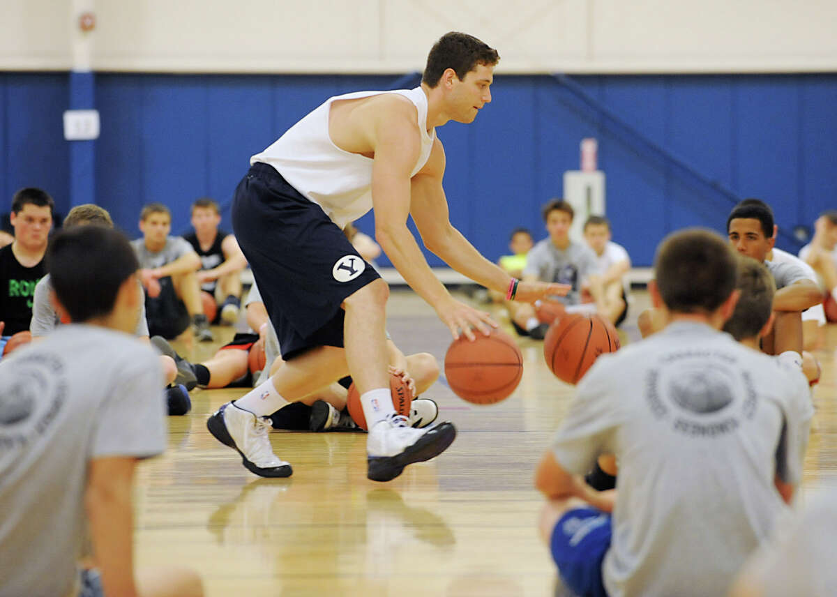Jimmer Fredette teaches aspiring basketball players some drills during Jimmer Jam Camp at the Saratoga Springs Recreation Center June 29, 2012 in Saratoga Springs, N.Y. (Lori Van Buren / Times Union)