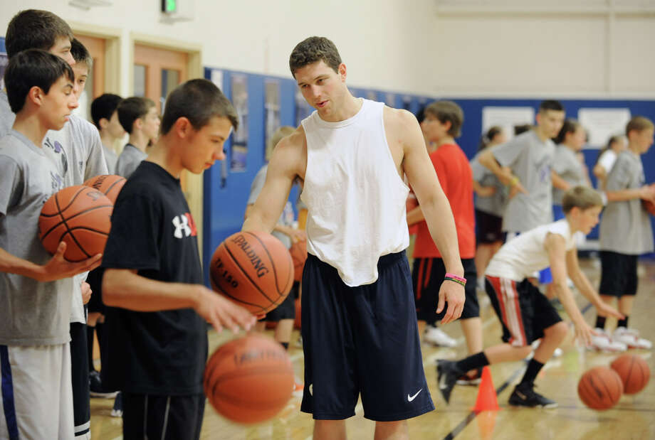 Jimmer Fredette teaches aspiring basketball players some drills during Jimmer Jam Camp at the Saratoga Springs Recreation Center June 29, 2012 in Saratoga Springs, N.Y.  (Lori Van Buren / Times Union) Photo: Lori Van Buren