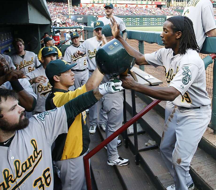 Oakland Athletics second baseman Jemile Weeks celebrates at the A's dugout after scoring in the fourth inning against the Texas Rangers at Rangers Ballpark in Arlington, Texas, Friday, June 29, 2012. (Paul Moseley/Fort Worth Star-Telegram/MCT) Photo: Paul Moseley, McClatchy-Tribune News Service