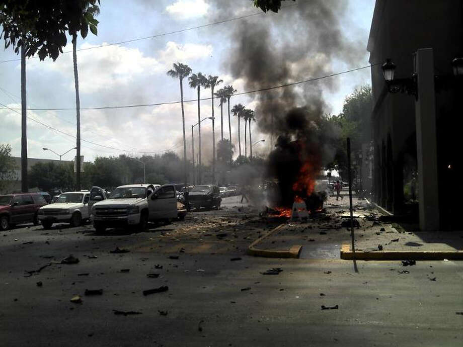Explosives in a Ford Ranger pickup parked at Nuevo Laredo's city hall exploded shortly after 11 a.m., injuring bystanders and damaging vehicles. Photo: Zapata Times