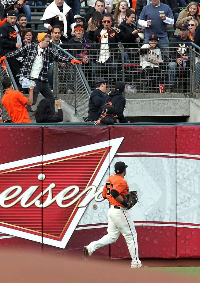 San Francisco Giants' Melky Cabrera watches Cincinnati Reds Zack Cozart home run ball go over the left field fence in the first inning of their MLB baseball game Friday, June 29, 2012, in San Francisco. Photo: Lance Iversen, The Chronicle