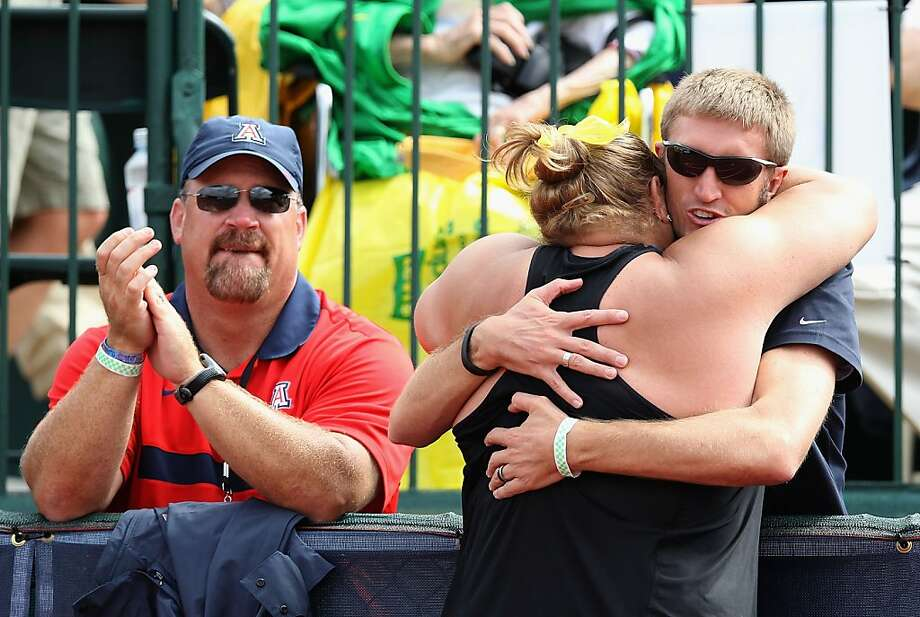 EUGENE, OR - JUNE 29:  Jillian Camarena-Williams hugs her husband Dustin Williams after winning the Women's Shot Put Final on day eight of the U.S. Olympic Track & Field Team Trials at the Hayward Field on June 29, 2012 in Eugene, Oregon.  (Photo by Christian Petersen/Getty Images) Photo: Christian Petersen, Getty Images