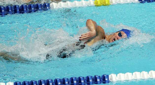 Amanda Weir swims in the women's 100-meter freestyle preliminaries at the U.S. Olympic swimming trials, Friday, June 29, 2012, in Omaha, Neb. (AP Photo/Nati Harnik) Photo: Associated Press