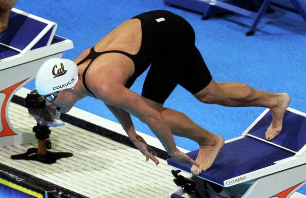 Natalie Coughlin dives at the start of a heat in the women's 100-meter freestyle preliminaries at the U.S. Olympic swimming trials, Friday, June 29, 2012, in Omaha, Neb. (AP Photo/Nati Harnik) Photo: Associated Press