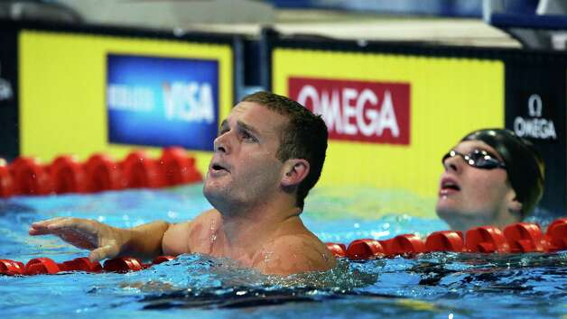 Tyler Clary, left, and Jack Conger react after swimming in the men's 200-meter backstroke preliminaries at the U.S. Olympic swimming trials on Friday, June 29, 2012, in Omaha, Neb. (AP Photo/Mark Humphrey) Photo: Associated Press