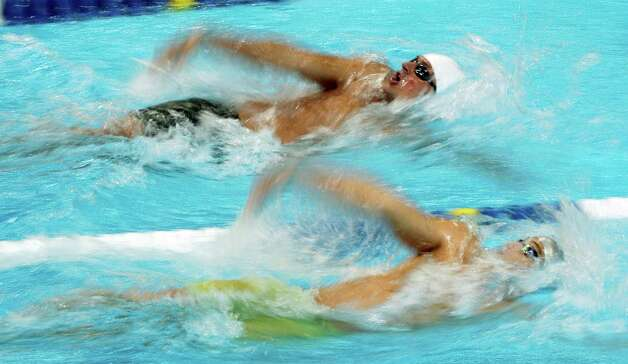 Ryan Lochte, top, and Rex Tullius swim in the men's 200-meter backstroke preliminaries at the U.S. Olympic swimming trials, Friday, June 29, 2012, in Omaha, Neb. (AP Photo/Nati Harnik) Photo: Associated Press