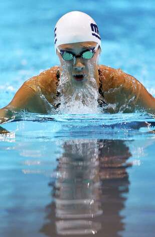 Micah�Lawrence swims in the women's 200-meter breaststroke preliminaries at the U.S. Olympic swimming trials, Friday, June 29, 2012, in Omaha, Neb. (AP Photo/Mark Humphrey) Photo: Associated Press