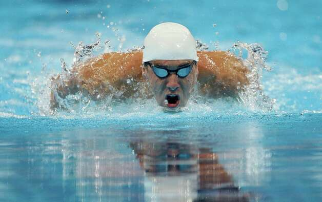 Michael Phelps swims in the men's 200-meter individual medley preliminaries at the U.S. Olympic swimming trials on Friday, June 29, 2012, in Omaha, Neb. (AP Photo/Mark Humphrey) Photo: Associated Press
